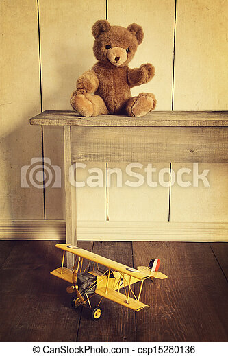 Antique toys on wooden bench with vintage look - csp15280136