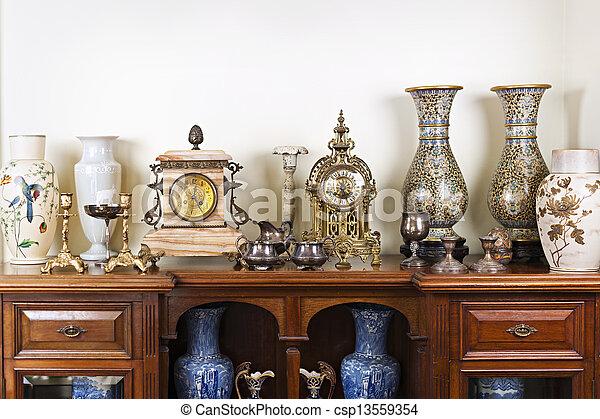 Antique vases and clocks - csp13559354