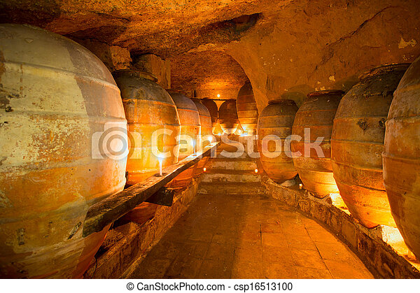 Antique winery in Spain with clay amphora pots - csp16513100
