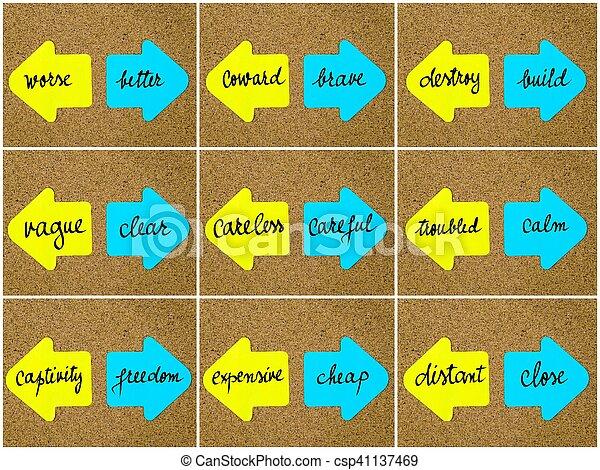 Antonym concepts written on opposite arrows - csp41137469