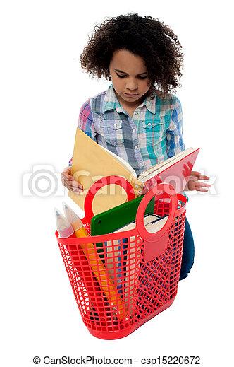 Anxious school girl reading a book - csp15220672