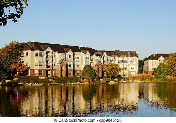 Apartment building complex on lake - csp9045125