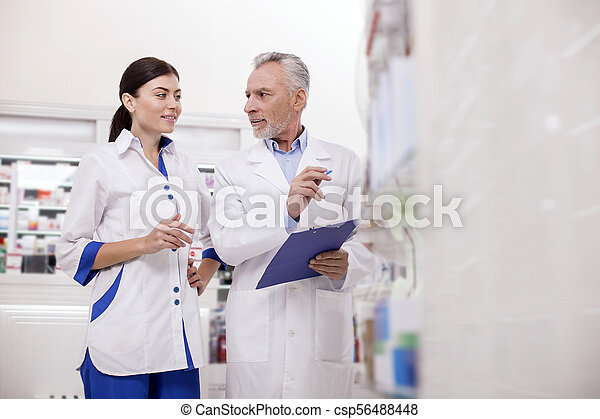 Appealing two pharmacists talking about medications