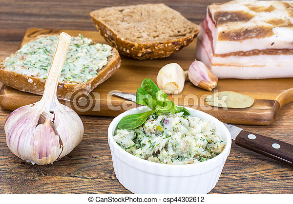 Appetizer of chopped bacon with garlic and herbs - csp44302612