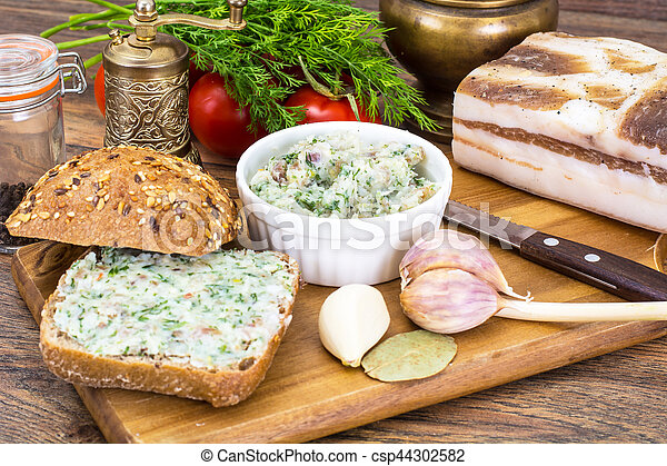 Appetizer of chopped bacon with garlic and herbs - csp44302582