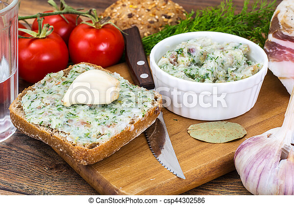Appetizer of chopped bacon with garlic and herbs - csp44302586