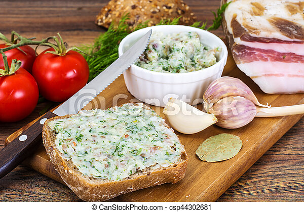 Appetizer of chopped bacon with garlic and herbs - csp44302681