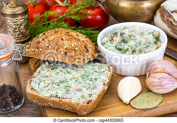 Appetizer of chopped bacon with garlic and herbs - csp44302663