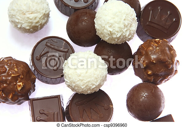appetizing chocolate candies with a nut and coconut are sparse on a white background - csp9396960
