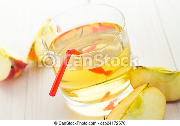 Apple juice apples wooden table - csp24172570