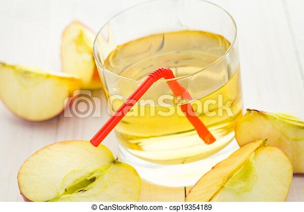 Apple juice apples wooden table - csp19354189