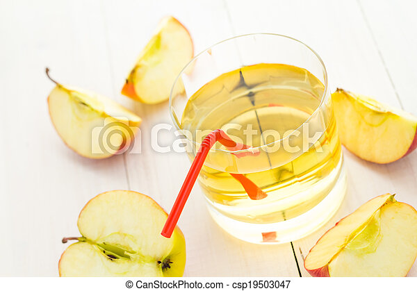 Apple juice apples wooden table - csp19503047