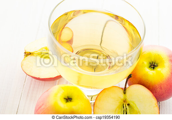 Apple juice apples wooden table - csp19354190