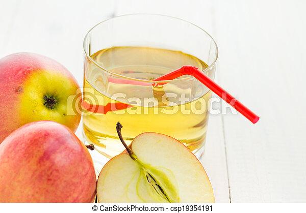 Apple juice apples wooden table - csp19354191