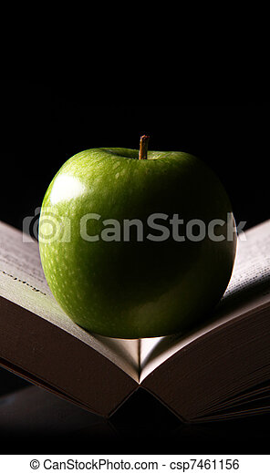 apple on a book - csp7461156