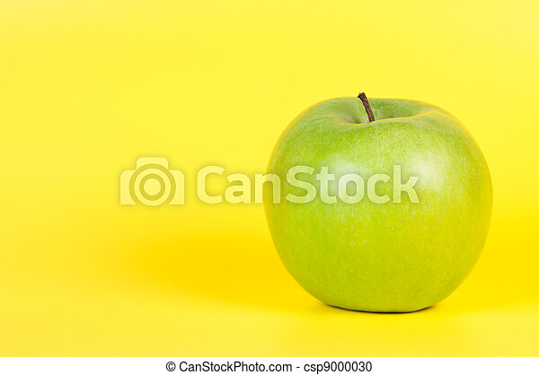 Apple on a yellow background. - csp9000030