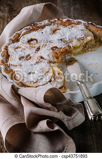 Apple pie with the knife on wooden table. - csp43751893