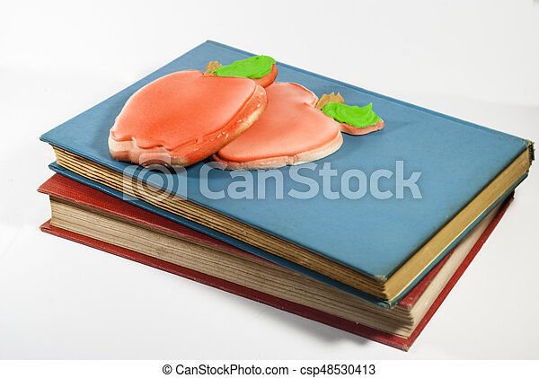 Apple-shaped cookies and books - csp48530413