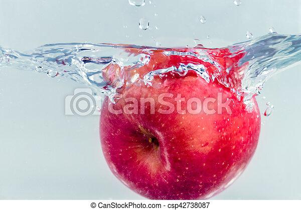 Apple splashing in water - csp42738087