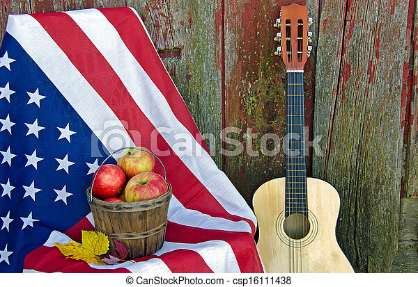 apples and guitar with flag - csp16111438
