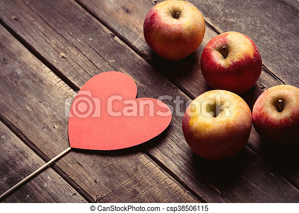 apples and heart shaped toy - csp38506115
