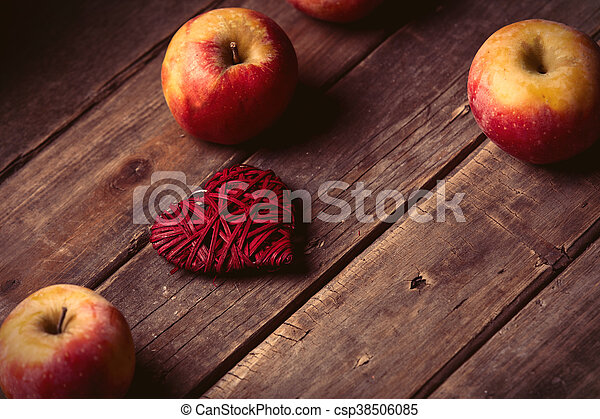 apples and heart shaped toy - csp38506085