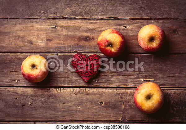 apples and heart shaped toy - csp38506168