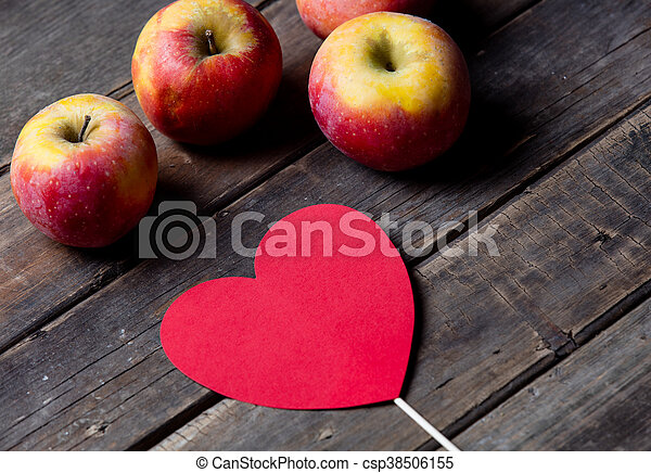 apples and heart shaped toy - csp38506155
