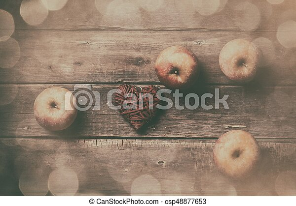 apples and heart shaped toy - csp48877653