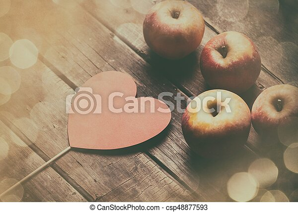 apples and heart shaped toy - csp48877593