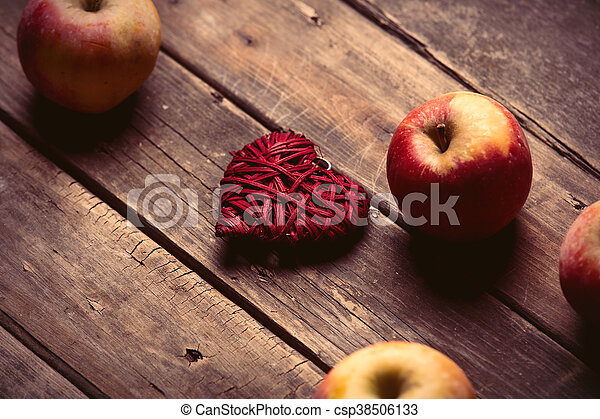 apples and heart shaped toy - csp38506133