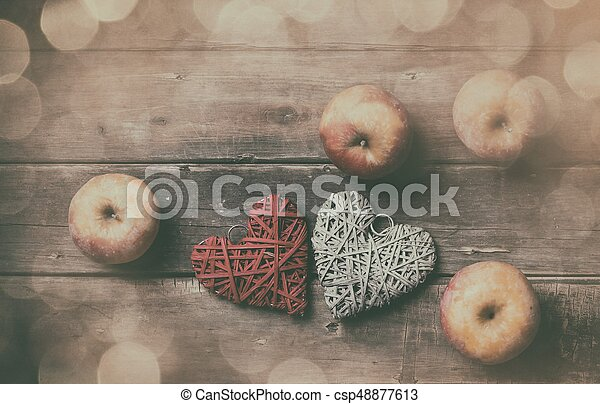 apples and heart shaped toys - csp48877613