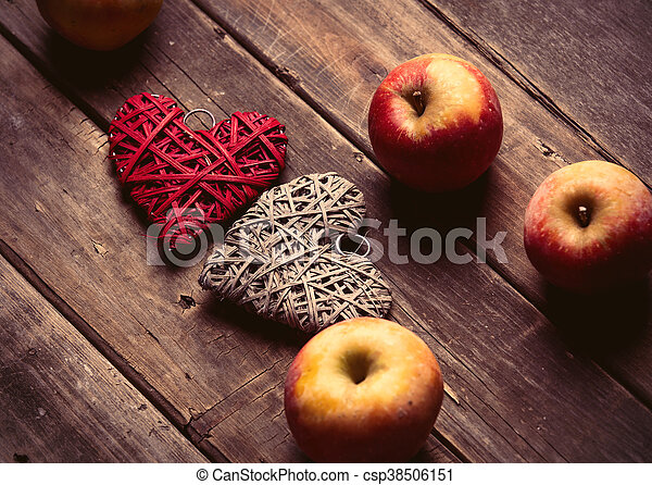 apples and heart shaped toys - csp38506151