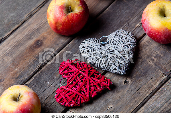 apples and heart shaped toys - csp38506120