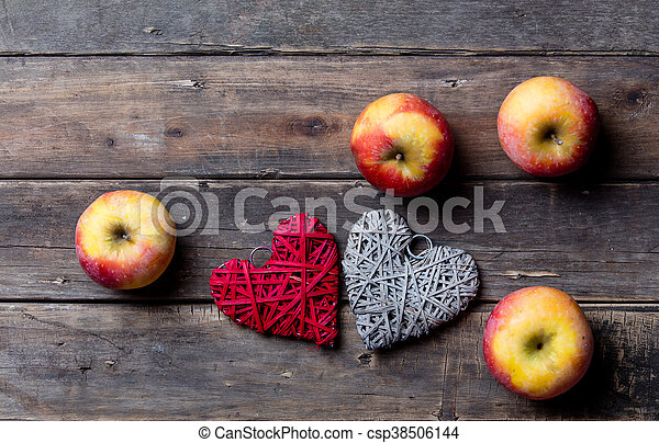 apples and heart shaped toys - csp38506144