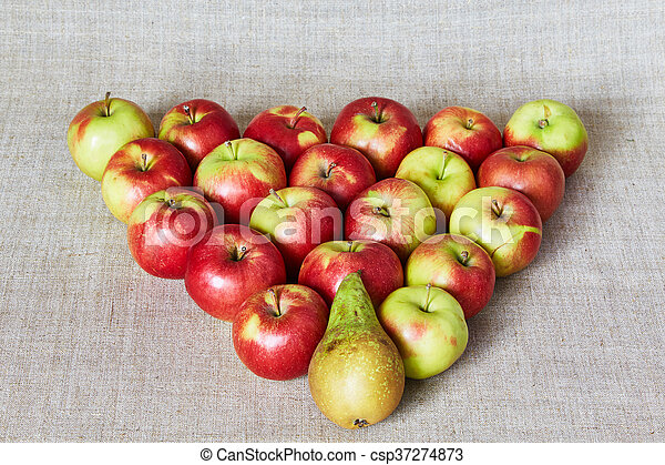 Apples and pear on a gray canvas - csp37274873