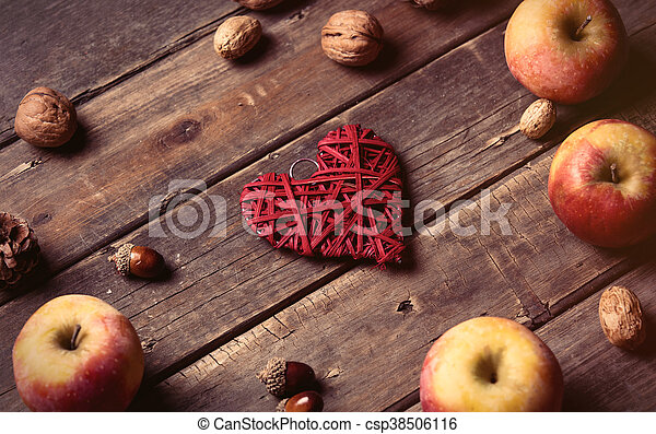 apples, heart shaped toy, fir-cone and nuts - csp38506116