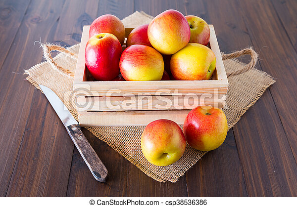 Apples in a wooden crate. - csp38536386