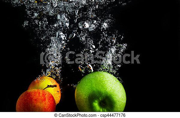 Apples in water - csp44477176