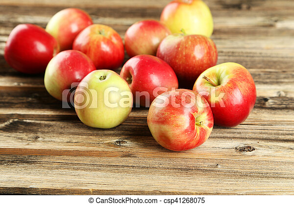 Apples on brown wooden background - csp41268075