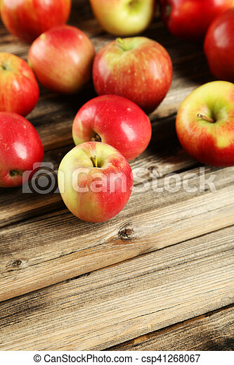 Apples on brown wooden background - csp41268067