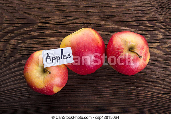 Apples on wooden background - csp42815064