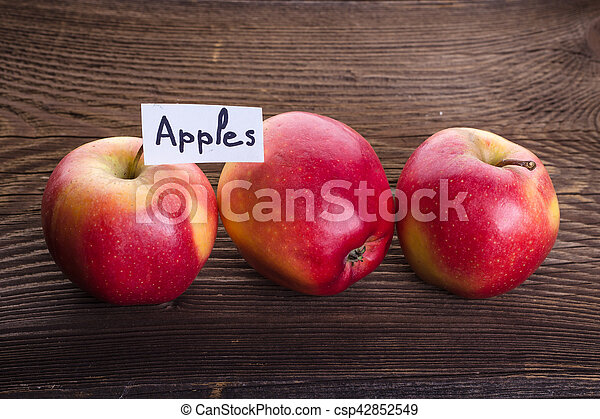 Apples on wooden background - csp42852549