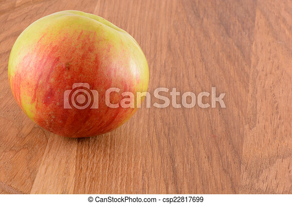 Apples on wooden background - csp22817699