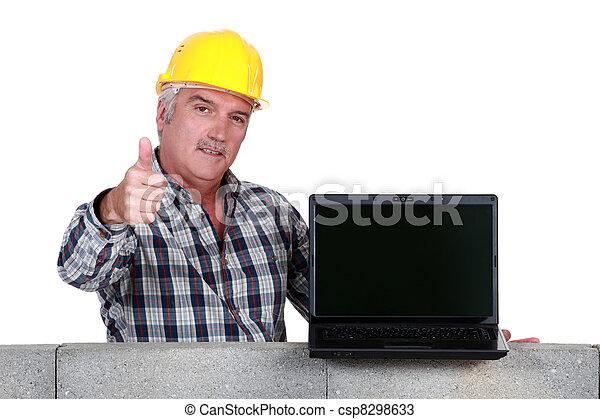 Approving tradesman embracing technology - csp8298633
