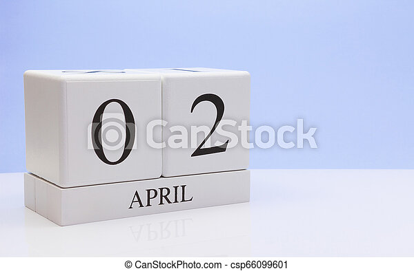 April 02st. Day 02 of month, daily calendar on white table with reflection, with light blue background. Spring time, empty space for text - csp66099601