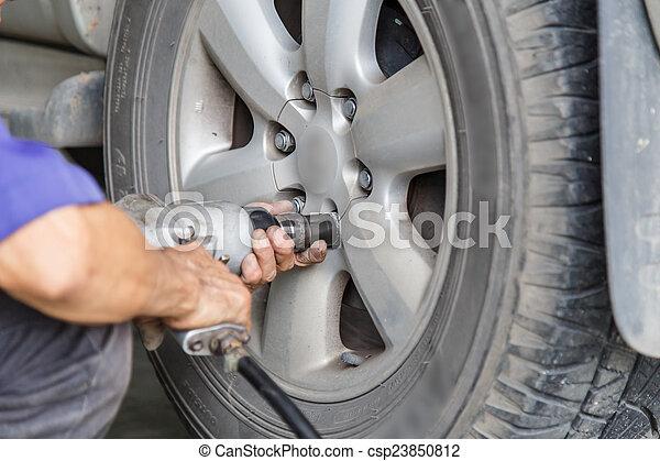 ar wheel changed by auto mechanic - csp23850812