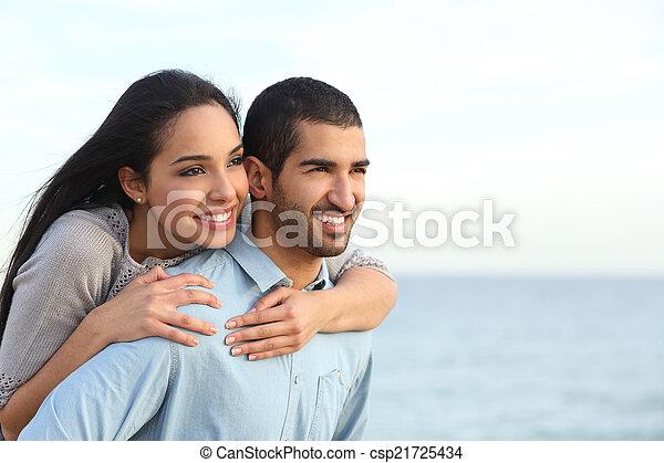 Arab couple flirting in love on the beach - csp21725434