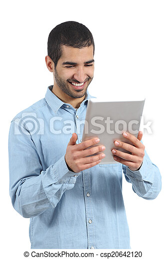 Arab happy casual man holding and reading a tablet reader - csp20642120