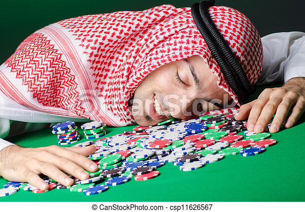 Arab playing in casino - gambling concept with man - csp11626567